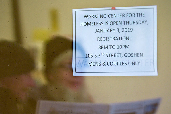 BEN MIKESELL   THE GOSHEN NEWS<br /> A sign for the new warming center is posted on a bulletin board as people leave The Window after lunch Thursday in downtown Goshen.