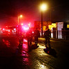 AUSTIN HOUGH | THE GOSHEN NEWS<br /> A group of firefighters are backlit by emergency lights at the scene of a fire at Recycled/New Pallets Inc. in Dunlap Monday night.