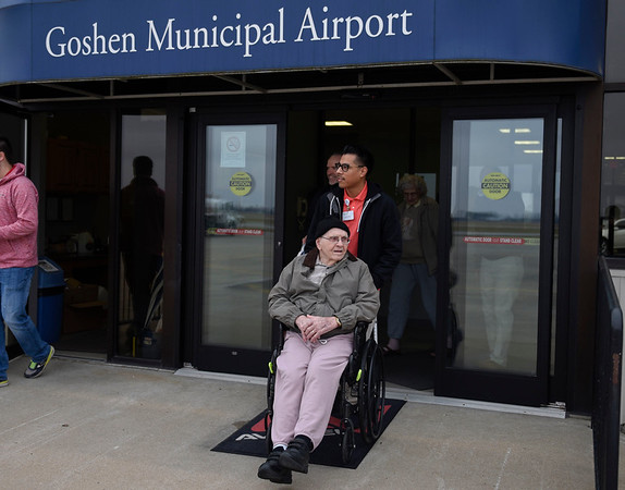 BEN MIKESELL | THE GOSHEN NEWS<br /> James Morales, Life Enrichment Director at Greenleaf Living Center, wheels resident Bill Overhulser out of the Goshen Municipal Airport to ride in a helicopter Wednesday morning.