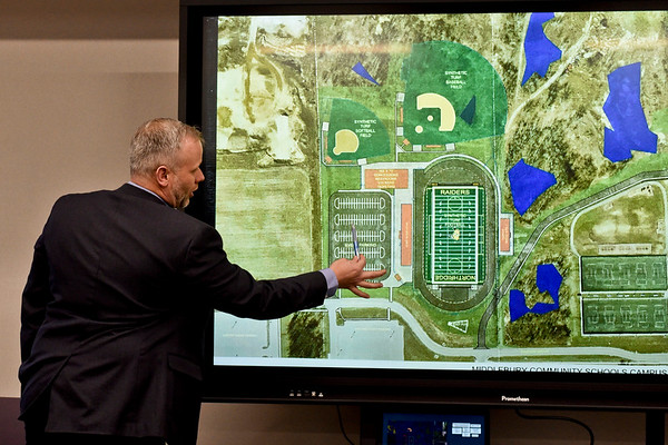 BEN MIKESELL | THE GOSHEN NEWS<br /> Director of buildings and grounds Jeff Palmer outlines the location of the proposed high school facilities during Friday's board meeting at the Middlebury Community Schools administration building. MCS owns the land north of the Northridge High School parking lot, where the proposed football field and baseball and softball complex could be built.