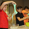 "JOHN KLINE | THE GOSHEN NEWS<br /> Lucas Alvarez-O'Connell, 10, left, and Itzae Juarez-Arreola, 10, both of Goshen, try their hand at making ""Jabba Slime"" during the Evil Genius: Star Wars program at the Goshen Public Library Monday afternoon."