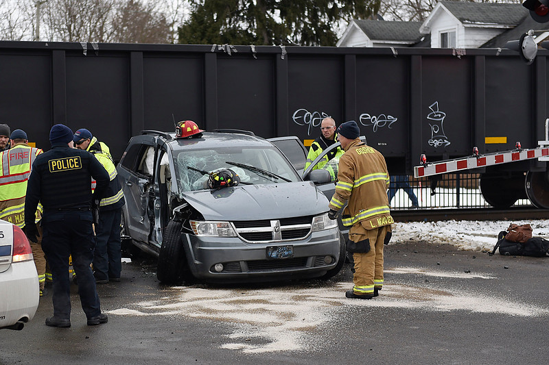BEN MIKESELL | THE GOSHEN NEWS First responders from Goshen Fire Department and Police Department help the passenger out of a van that was struck by a train Wednesday afternoon at 9th and Madison Streets in Goshen. The van was pushed a block north until it came to a rest at the intersection of 9th and Jefferson Street.