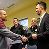 GEOFF LESAR | THE GOSHEN NEWS<br /> <br /> Juan Alvarez, left, of Goshen, shakes hands with Goshen Mayor Jeremy Stutsman as Assistant Chief Shawn Turner, back left, and Chief Jose Miller of the Goshen Police Department look on Thursday evening at the Boys & Girls Club in Goshen. Alvarez was one of four citizens, multiple GPD officers and Goshen Community Schools employees recognized Thursday for their handling of a Dec. 5 stabbing of a woman outside the Club and its aftermath. After witnessing an altercation in a vehicle, Alvarez said he was able to pull the suspect out of the vehicle by his feet. During a struggle to subdue the suspect, Alvarez said he was stabbed twice before the suspect fled on foot to a nearby vacant house, where he was later apprehended.