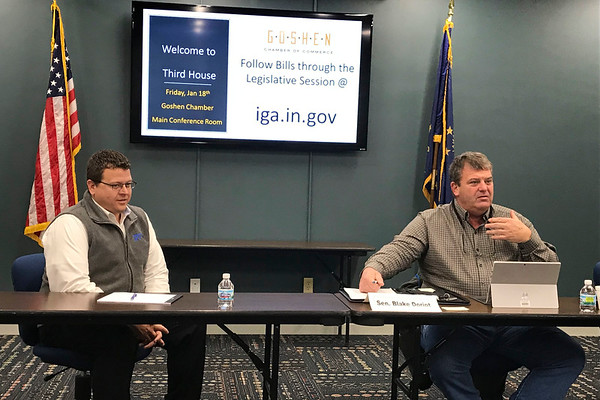 JOHN KLINE | THE GOSHEN NEWS Nick Kieffer, president of the Goshen Chamber of Commerce, left, and Sen. Blake Doriot, R-District 22, chat with attendees prior to the start of the first 2019 Third House town hall meeting at the chamber Friday morning.