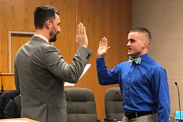JOHN KLINE | THE GOSHEN NEWS Goshen Mayor Jeremy Stutsman, left, conducts the swearing-in ceremony for Derek L. Weldy following his hiring as a probationary patrol officer with the Goshen Police Department during the Goshen Board of Public Works and Safety meeting Friday morning.