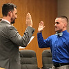 JOHN KLINE | THE GOSHEN NEWS<br /> Goshen Mayor Jeremy Stutsman, left, conducts the swearing-in ceremony for Derek L. Weldy following his hiring as a probationary patrol officer with the Goshen Police Department during the Goshen Board of Public Works and Safety meeting Friday morning.