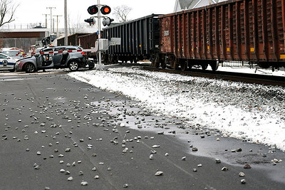 BEN MIKESELL | THE GOSHEN NEWS Rocks from the railroad are spread along 9th Street after a van was struck by a train Wednesday afternoon at 9th and Madison Streets in Goshen. The van was pushed a block north until it came to a rest at the intersection of 9th and Jefferson Street.