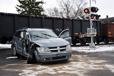 BEN MIKESELL | THE GOSHEN NEWS A van rests at the intersection of 9th and Jefferson Streets after it was struck by a train Wednesday afternoon at 9th and Madison Streets in Goshen. The van was pushed a block north until it came to a rest at the next intersection.