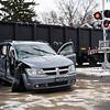 BEN MIKESELL | THE GOSHEN NEWS<br /> A van rests at the intersection of 9th and Jefferson Streets after it was struck by a train Wednesday afternoon at 9th and Madison Streets in Goshen. The van was pushed a block north until it came to a rest at the next intersection.