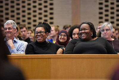 BEN MIKESELL | THE GOSHEN NEWS Professor Regina Shands Stoltzfus, left, and LaKendra Hardware, associate director for diversity, equity and inclusion, laugh during Goshen College President Rebecca Stoltzfus's address Wednesday at College Mennonite Church.