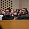 BEN MIKESELL | THE GOSHEN NEWS<br /> Professor Regina Shands Stoltzfus, left, and LaKendra Hardware, associate director for diversity, equity and inclusion, laugh during Goshen College President Rebecca Stoltzfus's address Wednesday at College Mennonite Church.