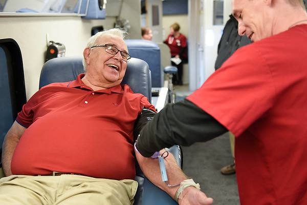 "BEN MIKESELL | THE GOSHEN NEWS<br /> Bethany Christian Schools teacher Dan Bodiker laughs with American Red Cross team lead Shaun Widmeyer while donating blood Tuesday in the parking lot of Bethany Christian. Bodiker donates blood regularly for the Red Cross, who announced this month a blood shortage in Northern Indiana. People interested in donating can make an appointment at  <a href=""http://www.redcross.org"">http://www.redcross.org</a>"