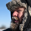 BEN MIKESELL | THE GOSHEN NEWS<br /> Ice begins to form on the face of Ryan Baker, a livestock farmer in Bristol, as he tends to his cows in the extreme sub-zero temperatures Thursday morning. With one of his cows in labor, Baker doesn't have the luxury of staying indoors or keeping his outdoor exposure to the recommended 10 minutes.