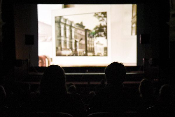 BEN MIKESELL | THE GOSHEN NEWS<br /> After tours, people watch a documentary on the history of the Goshen Theater Wednesday afternoon for Goshen Theater Week.