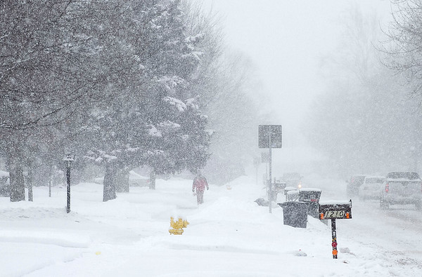 SAM HOUSEHOLDER | THE GOSHEN NEWS<br /> A man walks through heavy snow along 15th Street in Goshen Tuesday as snow fell. Several inches of snow has fallen over the last few days.