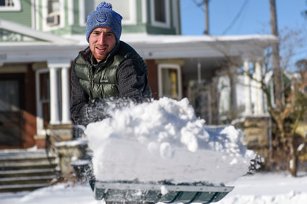 BEN MIKESELL | THE GOSHEN NEWS<br /> Andrew Buschert, of Goshen, shovels snow from a parking spot on Sixth Street in sub-zero temperatures Wednesday morning in Goshen. With wind chill, temperatures mid-day were around minus 46 degrees, according to the National Weather Service.