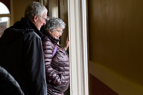 BEN MIKESELL | THE GOSHEN NEWS<br /> Susan Mark Landis and her husband Dennis Landis, Goshen, look out a window from the top floor of the Goshen Theater during a tour Wednesday.