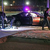 Roger Schneider | The Goshen News<br /> A Goshen police officer places a blanket over the driver of a car who reportedly led police on a long, low-speed chase after refusing to stop. The chase ended with police gunfire along West Washington Street just west of Third Street.