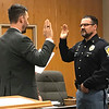 JOHN KLINE | THE GOSHEN NEWS<br /> Goshen Mayor Jeremy Stutsman, left, conducts the swearing-in ceremony for Christopher C. Juroff following his promotion from the rank of sergeant to the rank of captain with the Goshen Police Department during the Goshen Board of Public Works and Safety meeting Monday afternoon.