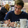 BEN MIKESELL | THE GOSHEN NEWS<br /> Goshen High School sophomore Luke Sommers creates three-dimensional shapes using toothpicks and marshmallows during Thursday's Teen Cafe at Goshen Public Library.