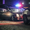Roger Schneider | The Goshen News<br /> A car with a blown out passenger window sits on West Washington facing east. The car was involved in a long chase that started in Goshen, went south through New Paris and ended back in Goshen. A Goshen officer fired his weapon at the conclusion of the chase.