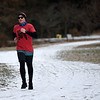 BEN MIKESELL | THE GOSHEN NEWS<br /> Collin Gruntman, of Goshen, runs down the snow-covered Millrace Trail Friday afternoon near the Rieth Interpretive Center. The National Weather Service of Northern Indiana has issued a Winter Weather Advisory for Elkhart County, where two to four inches of snow is expected to fall Saturday.