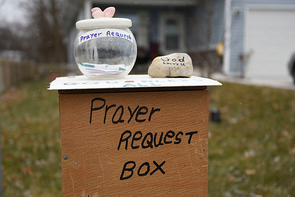 "BEN MIKESELL | THE GOSHEN NEWS<br /> A prayer box stands near the edge of Donna Harkins's yard at 219 Olive St. in Goshen. Harkins was inspired by the 2018 movie ""The Prayer Box"" to set up her own box and take prayer requests from the community. Since setting it up, she has received four requests, which she has posted on Facebook. ""This time of year with everything going on, everyone needs a prayer,"" Harkins said."