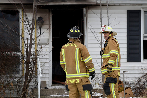 BEN MIKESELL | THE GOSHEN NEWS<br /> Turkey Creek fire chief Mickey Scott speaks with firefighter Quinn Hunter during a house fire Thursday at 304 S Syracuse-Webster Rd. near Wawasee High School in Syracuse. The residents of the home, Terry and Jody Moser, safely evacuated. The fire was ruled as accidental and damages are estimated at $20,000, Scott said.