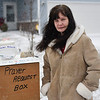 "BEN MIKESELL | THE GOSHEN NEWS<br /> Donna Harkins stands with a  prayer box she has placed near the edge of her yard at 219 Olive St. in Goshen. Harkins was inspired by the 2018 movie ""The Prayer Box"" to set up her own box and take prayer requests from the community. Since setting it up, she has received four requests, which she has posted on Facebook. ""This time of year with everything going on, everyone needs a prayer,"" Harkins said."