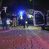 Roger Schneider | The Goshen News<br /> Goshen paramedics and police officers assist the driver of a car who reportedly fled police and led them on a long chase that ended along West Washington Street just west of Third Street. Police fired shots as the chase ended.