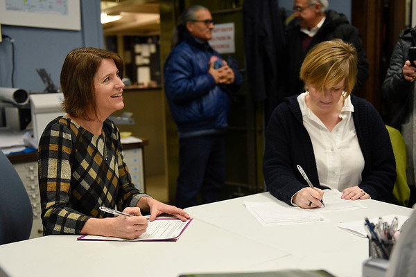 BEN MIKESELL | THE GOSHEN NEWS<br /> Democratic Goshen City Council member Julia King, left, smiles as she files her candidacy paperwork declaring her intent to again seek the Democratic nomination for her at-large seat in the upcoming May 7  primary election Wednesday at the Elkhart County Courthouse.