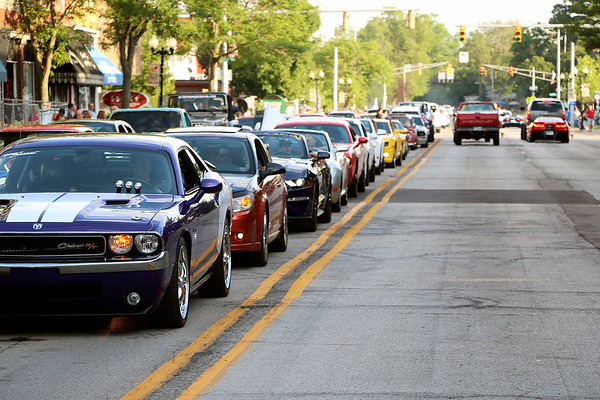 Roger Schneider | The Goshen News<br /> A line of classic cars fill two lanes of South Main Street in downtown Goshen Friday night.