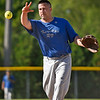 BEN MIKESELL | THE GOSHEN NEWS<br /> Todd Crawley, of Elkhart, delivers a pitch during Monday's softball league game at Shanklin Park in Goshen.