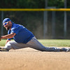 BEN MIKESELL | THE GOSHEN NEWS<br /> Jeremy Housley, of Dunlap, stretches to make an out at second base during Monday's softball league game at Shanklin Park in Goshen.