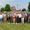 BEN MIKESELL | THE GOSHEN NEWS<br /> Members from JD Construction and Blue Gate Restaurant pose for a photo as they break ground on the new Blue Gate Performing Arts Center Wednesday in Shipshewana.