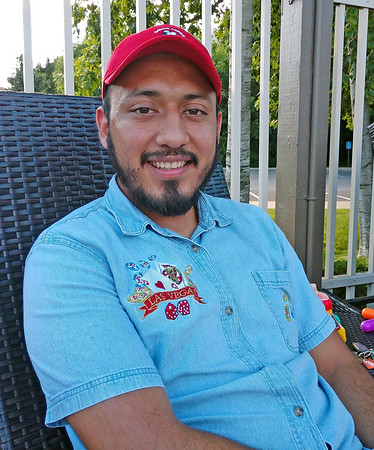 AIMEE AMBROSE | THE GOSHEN NEWS <br /> While relaxing at a local pool, Peter Ordonez, Elkhart, shares his thoughts on President Trump as the president's campaign launches an initiative to recruit Latino voters ahead of the 2020 elections.