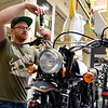 BEN MIKESELL | THE GOSHEN NEWS<br /> Lead assembly technician Ryan Roberts finishes pumping the brakes on a Gryffin 250 in the shop Tuesday afternoon at Janus Motorcycles in Goshen. The motorcycle shop is sending three show models to the White House on July 15, to represent Indiana in the Made in America Product Showcase.