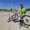 AIMEE AMBROSE | THE GOSHEN NEWS <br /> John Beeson, an Elkhart County Landfill employee, stands with bicycles he recently restored. Beeson fixes up discarded bikes and provides them free to Elkhart County Work Release offenders who need rides.