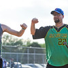 BEN MIKESELL | THE GOSHEN NEWS<br /> Bryan Kauffman, of Goshen, right, celebrates with Dustin Osos, of Angola, after scoring a run in Monday's softball league game at Shanklin Park in Goshen.