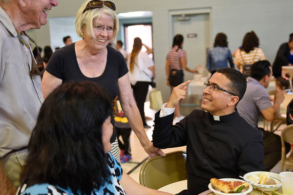 BEN MIKESELL | THE GOSHEN NEWS<br /> Father Jose Arroyo speaks with members of St. John's Catholic Church during an ice cream social Sunday at the church, where he was announced the new priest. Arroyo was previously with the parish at St. Joseph Catholic Church in Fort Wayne.