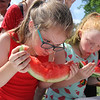 AIMEE AMBROSE | THE GOSHEN NEWS <br /> Emily Stanford, 10, Springs, Colorado gulps down a bite of watermelon while competing in the kids watermelon contest during the Bristol Homecoming Festival at Congdon Park Saturday.