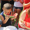 AIMEE AMBROSE | THE GOSHEN NEWS <br /> Draven Linares, 5, Elkhart, chows into a watermelon while participating in the kids watermelon eating contest during the Bristol Homecoming Festival at Congdon Park Saturday.