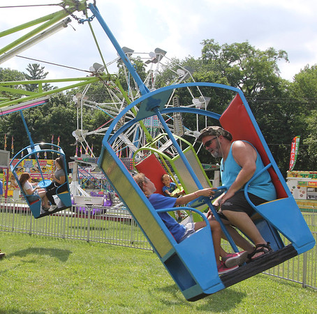 AIMEE AMBROSE | THE GOSHEN NEWS <br /> Children and adults enjoyed a whirl on the Frolic carnvial ride during the Bristol Homecoming Festival at Congdon Park Saturday.