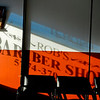 BEN MIKESELL | THE GOSHEN NEWS<br /> Sunlight peaks through the window at Rob's Barber Shop in Bristol. Rob Drake bought the barber shop when he was 18, and has now owned the shop for 18 years.
