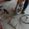 BEN MIKESELL | THE GOSHEN NEWS<br /> Beeson replaces a bent tire rim on a bicycle during his lunch break Monday at the Elkhart County Landfill.