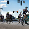 "BEN MIKESELL | THE GOSHEN NEWS<br /> Annette DeGuch, of South Bend, waves as she rides with a section of the Cops Cycling for Survivors as they turned onto U.S. 20 Thursdsay in Middlebury. The bicyclists, made up of police officers and supporters, ride nearly 1000 miles across the state to honor fallen officers every year. DeGuch has participated in the ride for eight years to honor her husband Paul, a South Bend police officer who died in 1997. ""We ride every year to keep their memories alive,"" DeGuch said."