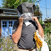 BEN MIKESELL | THE GOSHEN NEWS<br /> Tom Hassan, of Goshen, is a bee enthusiast who has had Italian bees in his backyard for three years. Because of his height, he had to make is own custom beekeeping suit.