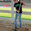 CAMDEN CHAFFEE | THE GOSHEN NEWS<br /> Eden Carey takes part in the LaGrange County 4-H Fair set-up by sweeping out grass and other debris from a large animal barn Tuesday.