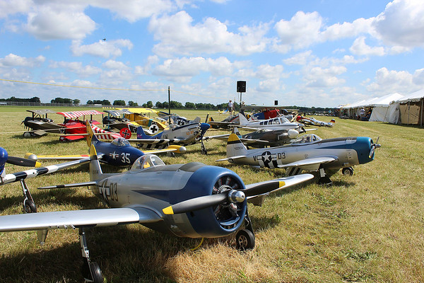 CAMDEN CHAFFEE | THE GOSHEN NEWS<br /> Rows of model airplanes sit waiting to be flown at the Air Supremacy Over Goshen Thursday at the Goshen Municipal Airport.