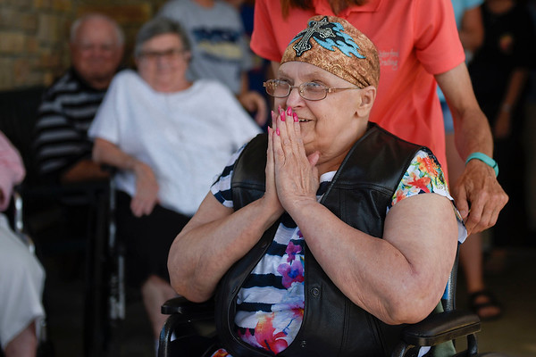 BEN MIKESELL | THE GOSHEN NEWS<br /> Carolyn Welch, 71, Goshen, smiles as she notices friends and family gathered to send her off on a motorcycle ride Wednesday evening at Waterford Crossing.